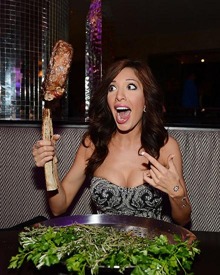 Farrah-Abraham-Showing-off-Massive-Tomahawk-Steak-at-N9NE-Steakhouse